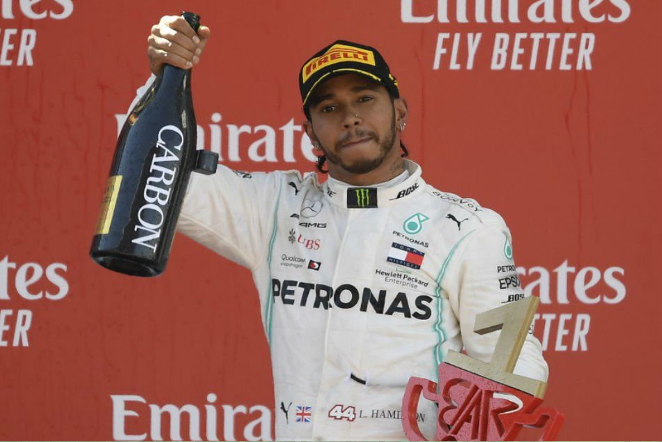 Lewis Hamilton wins in Spain to take championship lead