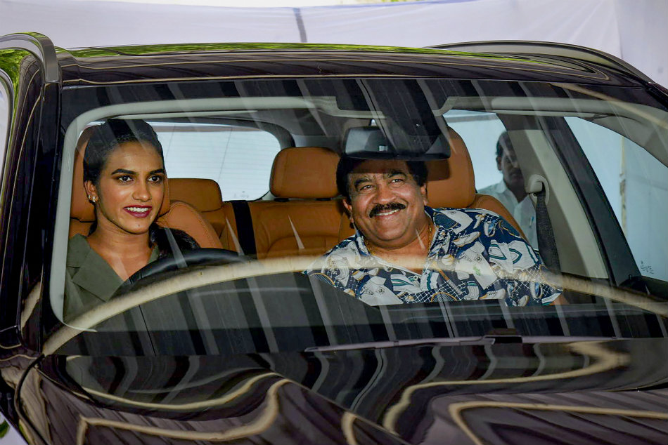 Nagarjuna Gifted BMW Car to Badminton Star PV Sindhu