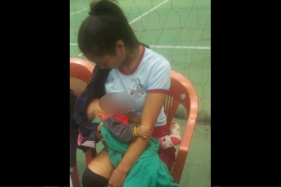 Mizoram volleyball player breastfeeds child on field in between game